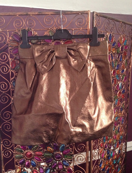 http://www.ebay.co.uk/itm/H-M-Bronze-Leather-Vintage-Unique-High-Waisted-Skirt-Size-10-/251244485616?pt=UK_Women_s_Skirts&hash=item3a7f569bf0